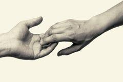 Två händer - sära Arkivbild