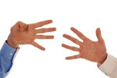 Två händer som figurerar nummer nio Arkivbild