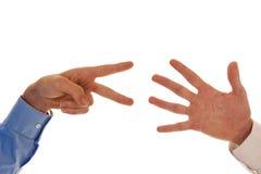 Två händer som figurerar nummer sju Fotografering för Bildbyråer