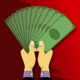 Två händer som rymmer mycket pengarpapper, formade som en fan Arkivbilder