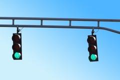 Två hängande trafiksignaleringar med klartecken Royaltyfri Fotografi