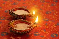 Två härlig Lit Diya för Diwali berömmar Royaltyfria Foton