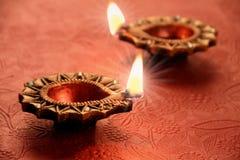 Två härlig Lit Diya för Diwali berömmar Royaltyfri Fotografi