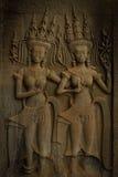 Två härliga Apsaras med harmoniskt leende Fotografering för Bildbyråer
