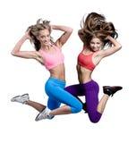 Hoppa för två härligt idrotts- flickor Royaltyfri Foto
