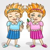Två härliga små flickor kopplar samman med blommavect Royaltyfria Bilder