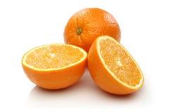 Två halv apelsin och apelsin Fotografering för Bildbyråer