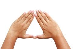 Två hand - gjord triangelform royaltyfria bilder