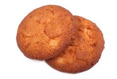 Två havremjöl, söta hemlagade kakor som isoleras på en vit bakgrund produkter för bageridesignbild Kakor för vaniljkrämsmörgås Royaltyfri Fotografi