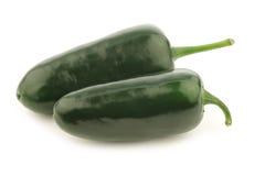 Två hela gröna jalapenopeppar Royaltyfria Bilder