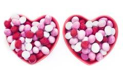 Två hjärta formade godisdisk Arkivbild