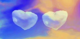 Två hjärtor har frambragt moln i den blåa himlen arkivbild