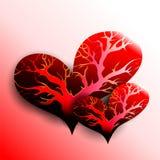 Två hjärtor med träd inom Arkivbild