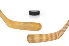 Två hockeypinnar och puck Royaltyfri Bild