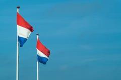 Två holländska flaggor i en rad Royaltyfria Bilder