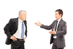 Två ilskna affärskollegor under ett argument Arkivfoto