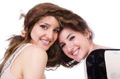 Två isolerade kvinnliga vänner Royaltyfri Bild