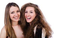 Två isolerade kvinnliga vänner Royaltyfria Foton