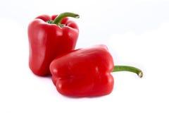 Två isolerade röda peppar Royaltyfri Fotografi