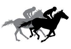 Två jockeyridninghästar Arkivbild