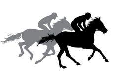 Två jockeyridninghästar Arkivbilder