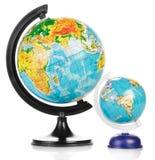 Två jordiska jordklot Arkivfoto