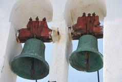 Två klockor på det kyrkliga tornet i Korfu, Grekland Fotografering för Bildbyråer