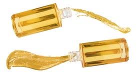 Två kosmetiska flaskor med oljafärgstänk Arkivbild