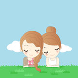 Två kvinnor som ligger på gräs stock illustrationer