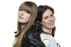 Två kvinnor tillbaka som ska dras tillbaka Fotografering för Bildbyråer