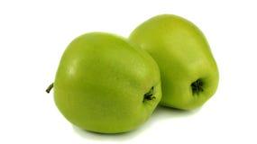 två läckra Apple på en vit bakgrund Arkivbilder