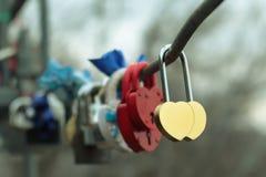 Två lås i form av hjärtor Arkivbild