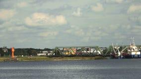 Två lastbilar som korsar bron stock video