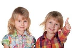 Två le nätt liten flicka royaltyfria foton