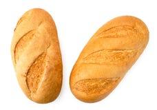 Två loaves av bröd på ett vitt Formen av ?verkanten royaltyfri fotografi