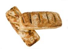 Två loaves av bröd som isoleras på vit Royaltyfria Bilder