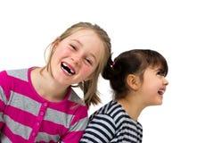 Två lyckliga små flickor royaltyfri bild