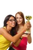 Två lyckliga vinnarear med prisen royaltyfri bild