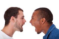 Två män som skriker på de royaltyfria bilder