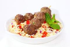 Meatball Kebabs över Couscous Arkivfoton