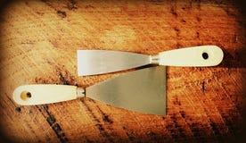 Två metallspatlar Arkivfoto