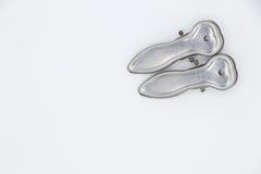 Två metalltorkdukegem på vit bakgrund Arkivbilder