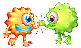 Två monster som visar teamwork Arkivbilder