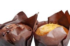Två muffin, brunt och vanilj Arkivfoton