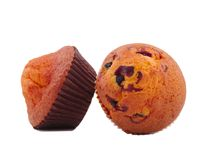 Två muffin på sidan av de på en vit isolerade bakgrund Arkivfoton
