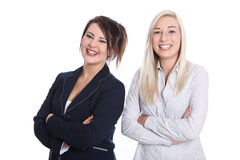 Två nöjda nätta kvinnor med vikta armar i affärskläder - Arkivbild