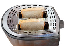 Två nya skivor av bröd i metallbrödrost Fotografering för Bildbyråer