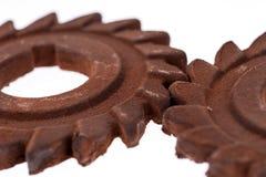 Två oerhörda rostiga chokladkugghjul Fotografering för Bildbyråer