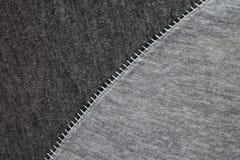 Två olika kulöra kläder sydde diagonalt in - between arkivfoto