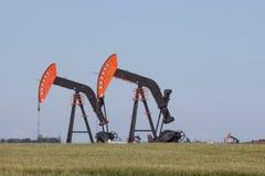 Två olje- brunnar Arkivfoto